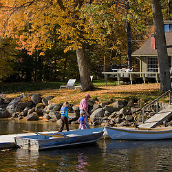 A dad and his three daughters on a dock at the Oliver Lodge in Meredith, New Hampshire.  Lake Winnipesauke.