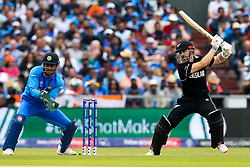 Kane Williamson of New Zealand bats as MS Dhoni of India looks on - Mandatory by-line: Robbie Stephenson/JMP - 09/07/2019 - CRICKET - Old Trafford - Manchester, England - India v New Zealand - ICC Cricket World Cup 2019 - Semi Final