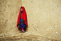Anbar Somuch, Afghanistan -- Rozia, 11, along the paths of the village of Anbar Somuch 25 kilometers west of Bamiyan in central Afghanistan in 2002 just months after families returned following the Taliban fleeing from U.S. troops. -- Photo by Jack Gruber, USA TODAY