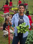 Culinary Arts instructor Kellie Karavias poses for a photograph with students in the garden at Gregory-Lincoln Middle School, November 21, 2013.