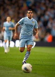 MANCHESTER, ENGLAND - Monday, April 30, 2012: Manchester City's Carlos Tevez in action against Manchester United during the Premiership match at the City of Manchester Stadium. (Pic by Chris Brunskill/Propaganda)