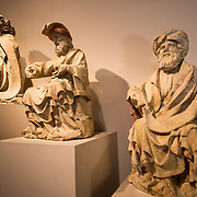 Historic statues on display at the Museum of the City of Brussels. The museum is dedicated to the history and folklore of the town of Brussels, its development from its beginnings to today, which it presents through paintings, sculptures, tapistries, engravings, photos and models.