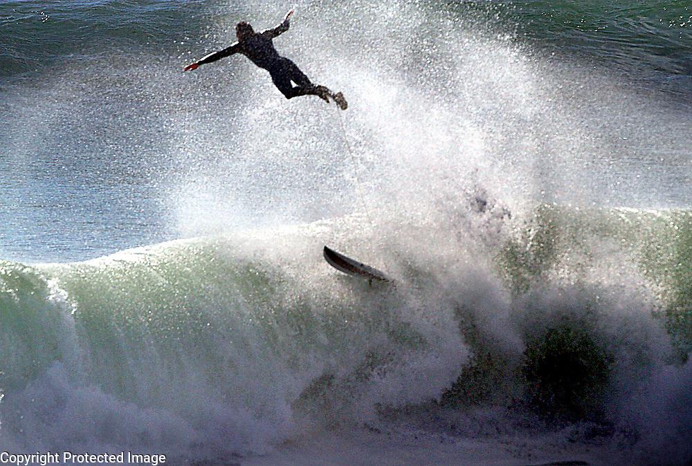 A surfer at Steamer Lane in Santa Cruz soars out of a wave after catching a ride off of Lighthouse Point.<br /> Photo by Shmuel Thaler <br /> shmuel_thaler@yahoo.com www.shmuelthaler.com