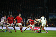 Steff Evans of Wales © tries to break away from Owen Farrell of England. England v Wales, NatWest 6 nations 2018 championship match at Twickenham Stadium in Middlesex, England on Saturday 10th February 2018.<br /> pic by Andrew Orchard, Andrew Orchard sports photography
