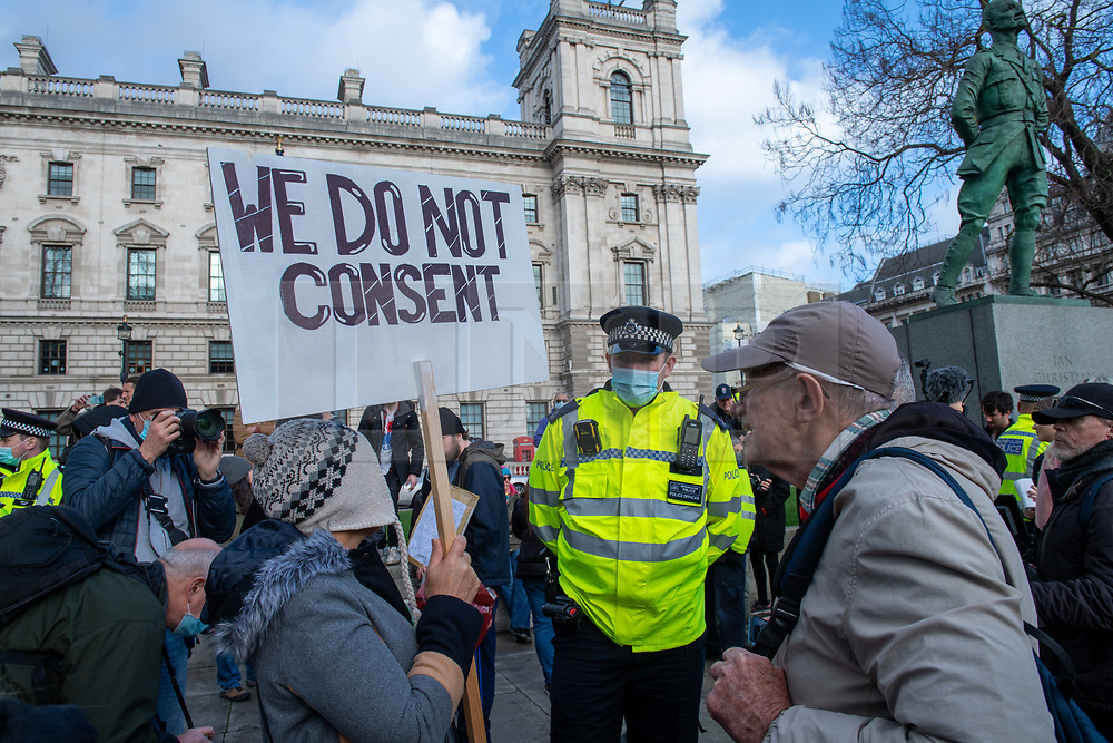 © Licensed to London News Pictures. 19/12/2020. London, UK. A protester holds a 'we do not consent' placard in Parliament Square. Protesters have gathered in central London for an anti-lockdown demonstration. Photo credit: Peter Manning/LNP