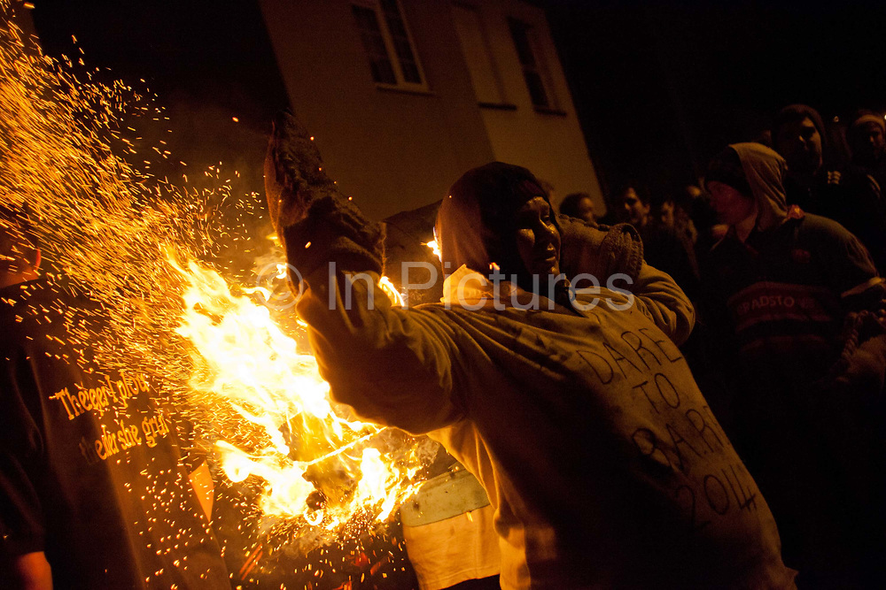 The annual running of the tar barrels in Ottery St Mary, Devon is a tradition thought to go back as far as 500 years. Every November the 5th, crowds of thousands flock to this small town in the south west of England to see men, women and children run with burning barrels on their shoulders. Only people who were born in Ottery are allowed to participate, and they are proud of the tradition and work hard to keep it alive, even in the face of health and safety regulations. It is not competitive but rather a supportive act where they pass the barrels between themselves, encouraging everyone in the team to have a go.
