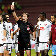 Referee Cagatay Sahan (C) and Trabzonspor's Erkan Zengin (R) during their Turkish Super League match Trabzonspor between Gaziantepspor at the Avni Aker Stadium at Trabzon Turkey on Wednesday, 28 October 2015. Photo by Aykut AKICI/TURKPIX