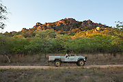 An old land rover in Matobo National Park, part of the Motopos Hills area in Zimbabwe. The park is an U.N. UNESCO World Hertiage Site. © Michael Durham / www.DurmPhoto.com