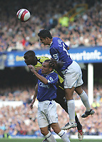 Photo: Andi Thompson.<br />Everton v Manchester City. The Barclays Premiership. 30/09/2006.<br />Everton's Tim Cahill beats City's Micah Richards to the ball