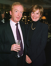 MR & MRS NICHOLAS WITCHELL he is the newsreader, at a party in London on 18th May 1999.MSD 34