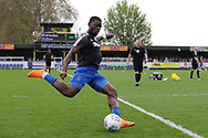 AFC Wimbledon defender Deji Oshilaja (4) warming up during the EFL Sky Bet League 1 match between AFC Wimbledon and Oldham Athletic at the Cherry Red Records Stadium, Kingston, England on 21 April 2018. Picture by Matthew Redman.