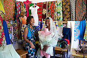 """Rahab Mbuba discussing dress designs with a customer.<br /> <br /> Rahab, also known as 'Mama B"""", set up and now runs a tailoring business, designing and making clothes.<br /> <br /> She attended MKUBWA enterprise training run by the Tanzania Gatsby Trust in partnership with The Cherie Blair Foundation for Women."""