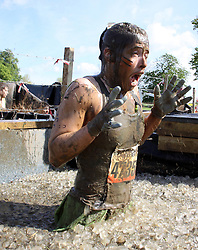 ©Licensed to London News Pictures. 13/05/2012.Boughton House, Northants. Tough Mudders endure the ice dip during 12 mile endurance challenge..Photo credit: Steven Prouse/ LNP