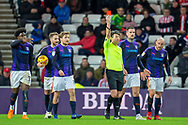 Referee Lee Probert shows a red card to Chris Maguire (#7) of Sunderland AFC during the EFL Sky Bet League 1 match between Sunderland AFC and Luton Town at the Stadium Of Light, Sunderland, England on 12 January 2019.