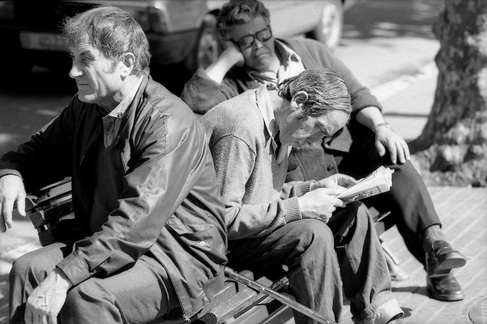 Men on a bench in Barcelona. Spain 1985.