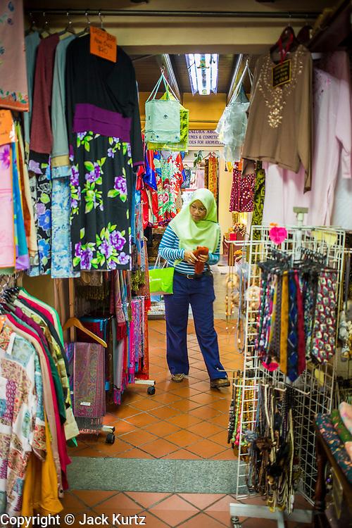 17 DECEMBER 2012 - SINGAPORE, SINGAPORE: A Muslim woman shops at a shopping arcade on Arab Street in Singapore.       PHOTO BY JACK KURTZ