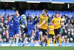 N'Golo Kante of Chelsea clears under pressure from Diogo Jota of Wolverhampton Wanderers - Mandatory by-line: Arron Gent/JMP - 10/03/2019 - FOOTBALL - Stamford Bridge - London, England - Chelsea v Wolverhampton Wanderers - Premier League