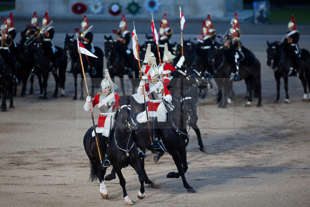 © Licensed to London News Pictures. LONDON, UK  08/06/11. . Horses and riders of the Life Guards (the British Army's senior cavalry regiment) wheel round as they take part in the opening night of the Beating the Retreat ceremony.  This year the opening night of Beating the Retreat took place with the American Ambassador receiving the salute. The traditional parade, involving all of the bands of the Household Division of the British Army, dates back to times when, after a day's battle, troops would retreat for the night.  Please see special instructions for usage rates. Photo credit should read Matt Cetti-Roberts/LNP