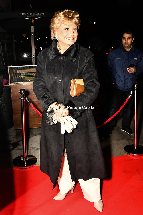 Angela Rippon Arrivers  Ray Burmiston - fundraising exhibition  at The Athenaeum Hotel, London, UK. 5th Feb 2019.