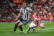 Craig Dawson of West Bromwich Albion turns Xherdan Shaqiri of Stoke City. Barclays Premier League match, Stoke city v West Bromwich Albion at the Britannia stadium in Stoke on Trent, Staffs on Saturday 29th August 2015.<br /> pic by Chris Stading, Andrew Orchard sports photography.