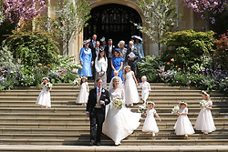 Newlyweds Thomas Kingston and Lady Gabriella Windsor pose on the steps of the chapel with their bridesmaids, page boys and guests after their wedding at St George's Chapel in Windsor Castle.