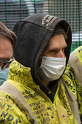 """© Licensed to London News Pictures.22/02/2021. London, UK. An Anti-HS2 campaigner known as """"Larch"""" leaves London's Euston Square Gardens after he was removed by bailiffs from a 100ft. Photo credit: Marcin Nowak/LNP"""