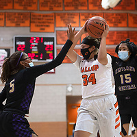 Gallup Bengal Jordan Joe (34) looks to pass as Kirtland Central Broncos Aisha Ramone (5) and Tyra Yazzie (15) defend at Gallup High School in Gallup Friday evening.
