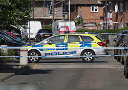 © Licensed to London News Pictures. 11/06/2018. London, UK. Police guard a cordon where a 17 year old was critically injured in a stabbing in Harrow last night. Police are also dealing with a stabbing incident in nearby Northolt where a 20 year old was injured. Photo credit: Peter Macdiarmid/LNP  Photo credit: Peter Macdiarmid/LNP