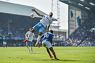 Coventry City Defender, Jordan Willis (4) beats Portsmouth Midfielder, Jamal Lowe (10) in the air during the EFL Sky Bet League 1 match between Portsmouth and Coventry City at Fratton Park, Portsmouth, England on 22 April 2019.