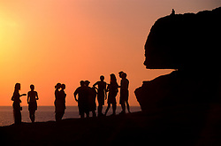 MALTA GOZO DWEJRA JUL00 - A group of toursist on the rocks above the window of Dwejra during sunset.. . jre/Photo by Jiri Rezac. . © Jiri Rezac 2000. . Tel:   +44 (0) 7050 110 417. Email: info@jirirezac.com. Web:   www.jirirezac.com
