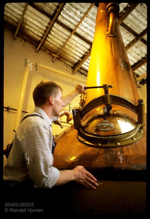 Stillman Ian Renwick shuts port on the spirit still @ Glenturret, Sctlnd's oldest distillry;Crieff Scotland