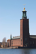 View to Stadshuset, the City Hall, over the Riddarfjarden, with its iconic tower with three crowns. Kungsholmen Stockholm. Sweden, Europe.