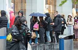 © Licensed to London News Pictures; 03/05/2021; Bristol, UK. Shoppers queue during wet and windy weather in Bristol's Broadmead shopping centre for a washout on the early May bank holiday. Photo credit: Simon Chapman/LNP.
