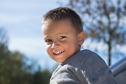 Smiling small young boy portrait close up