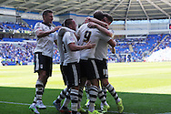 Matt Smith of Fulham (9) celebrates with his teammates after he scores his teams 1st goal. Skybet football league championship match, Cardiff city v Fulham at the Cardiff city stadium in Cardiff, South Wales on Saturday 8th August  2015.<br /> pic by Andrew Orchard, Andrew Orchard sports photography.