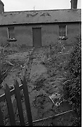 """Flooding at the Dodder..1986..26.08.1986..08.26.1986..28th August 1986..As a result of Hurricane Charly (Charlie) heavy overnight rainfall was the cause of severe flooding in the Donnybrook/Ballsbridge areas of Dublin. In a period of just 12 hours it was stated that 8 inches of rain had fallen. The Dodder,long regarded as a """"Flashy"""" river, burst its banks and caused great hardship to families in the 300 or so homes which were flooded. Council workers and the Fire Brigades did their best to try and alleviate some of the problems by removing debris and pumping out some of the homes affected..Note: """"Flashy"""" is a term given to a river which is prone to flooding as a result of heavy or sustained rainfall...After some of the flooding had receded sild and mud deposits were pictured right up to the door of the cottage."""