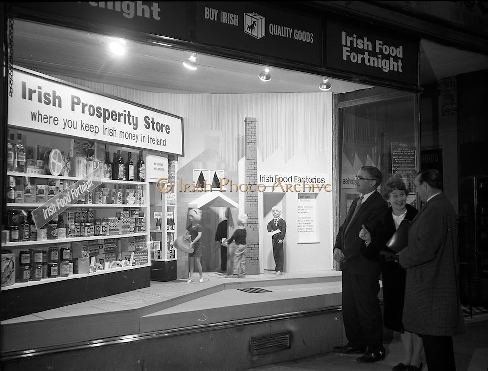 """14/11/1966<br /> 11/14/1966<br /> 14 November 1966<br /> Food Fortnight window display at N.A.I.D.A., St. Stephen's Green, Dublin.  Display announcing the """"Irish Food Fortnight"""" (Nov. 7-19) opened. Window """"depicts the importance to the housewife in her selection of food products of Irish manufacture, so that capital remains in the country's industry"""". The display was constructed by Modern Display Artists. Picture shows (l-r): Mr. Gerard Duffy, (Vice Chairman, R.G.D.A.T.A.); Miss Nuala Perry, Honorary Secretary, Food Fortnight Committee and Mr. Brian Doyle, (Chairman) viewing the display."""