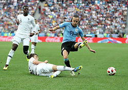 NIZHNY NOVGOROD, July 6, 2018  Diego Laxalt (R top) of Uruguay vies with Benjamin Pavard (bottom) of France during the 2018 FIFA World Cup quarter-final match between Uruguay and France in Nizhny Novgorod, Russia, July 6, 2018. France won 2-0 and advanced to the semi-finals. (Credit Image: © Fei Maohua/Xinhua via ZUMA Wire)