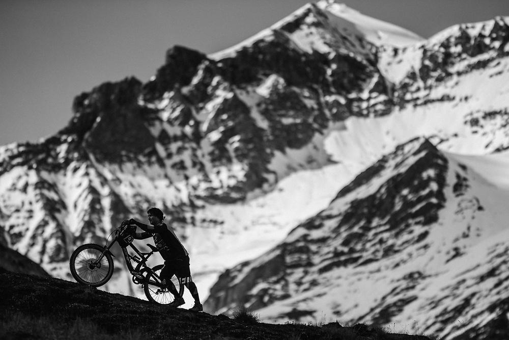 Tyler McCaul hikes with his bike in the Tatshenshini-Alsek Provincial Park in British Columbia, Canada on September 3, 2016.