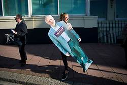 © Licensed to London News Pictures. 29/09/2015. Brighton, UK. A woman carrying a cardboard cutout of JEREMY CORBYN outside the entrance to the venue on  Day three of the 2015 Labour Party Conference, held at the Brighton Centre in Brighton, East Sussex. This years conference takes place just weeks after Jeremy Corbyn was elected leader of the party. Photo credit: Ben Cawthra/LNP