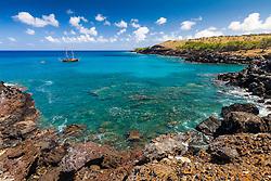 historical sailboat Libertatia, originally built in 1935, moored in a small, coral reef cove off Mahukona Beach Park, North Kohala, Big Island, Hawaii, USA, Pacific Ocean