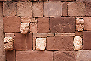 Detail from the Pre-Inca civilisation walls of Tiwanaku. Tiwanaku ruins outside of La Paz, Bolivia sits on the Altiplano, at an altitude of 3,850 m / 12,631 ft. One of the oldest and highest cities ever built. Active between 400 A.D. and 900 A.D this was largely an agrarian society with great skills for stone carving and irrigation technology.