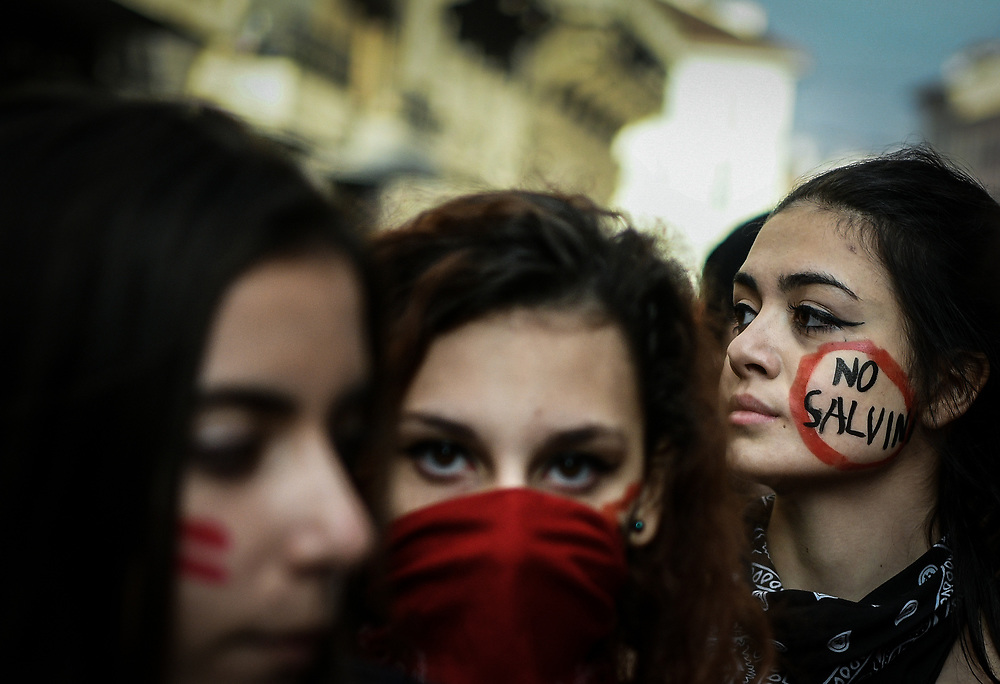 Milan, Italy - November 16, 2018: A protester displays a note on her cheek that reads 'No Salvini' while demonstrating during the 'No Salvini Day' students protest