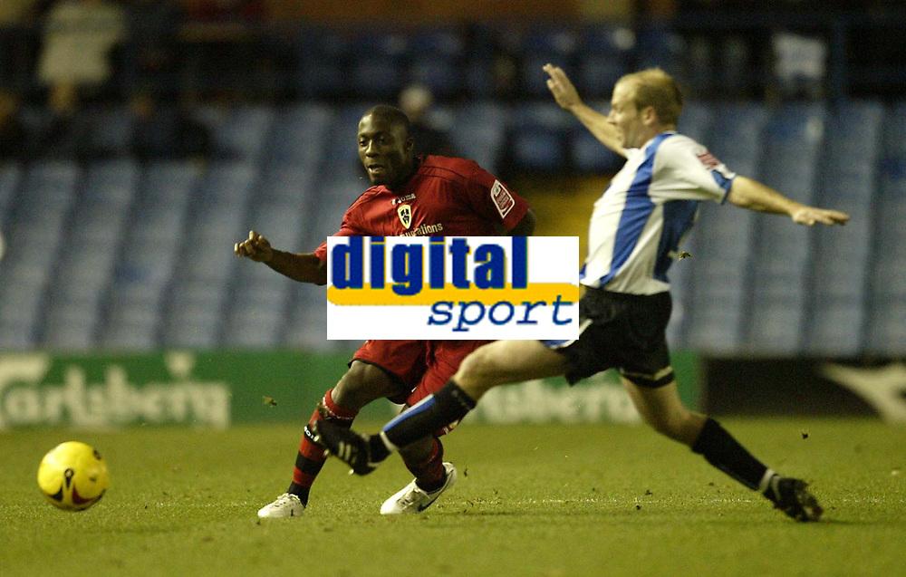 Photo: Aidan Ellis.<br /> Sheffield Wednesday v Cardiff City. Coca Cola Championship. 25/11/2006.<br /> Cardiff's Malvin Kamara plays a pass past Wednesday's John Hills