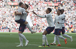 England's Gary Cahill (second left) celebrates scoring his side's first goal of the game with Kieran Trippier during the International Friendly match at Wembley Stadium, London.