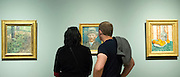 Visitors view self portrait by Vincent Van Gogh at Rijksmuseum, Amsterdam, Holland