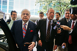 12 June  2015. New Orleans, Louisiana. <br /> Tom Benson (L), billionaire owner of the NFL New Orleans Saints, the NBA New Orleans Pelicans, various auto dealerships, banks, property assets and a slew of business interests leaves the New Orleans Civil District Court with his attorney Phillip Whitman where they are attending a hearing to determine Benson's level of competency to manage his business empire. Benson changed his succession plans and  decided to leave the bulk of his estate to third wife Gayle, sparking a controversial fight over control of the Benson business empire.<br /> Photo©; Charlie Varley/varleypix.com