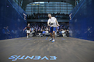 Cameron Piley of Australia (in the white shirt) vs  Mohaired Reda of Egypt (in the black shirt). Canary Wharf Squash Classic 2016 , day two at the East Wintergarden in Canary Wharf , London on Tuesday 8th March 2016.<br /> pic by John Patrick Fletcher, Andrew Orchard sports photography.