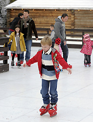 © Licensed to London News Pictures. 26/11/2011. Lamberhurst ,UK. Children ice skating on the opening day of LaplandUK  in Lamberhurst, Kent today (26/11/2011). The park which is recreated from scratch every year, recreates Father Christmas' arctic homeland. Photo credit : Grant Falvey/LNP
