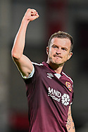 Andy Halliday (#16) of Heart of Midlothian FC gestures to the crowd after the final whistle of the Cinch SPFL Premiership match between Heart of Midlothian FC and Celtic FC at Tynecastle Park, Edinburgh, Scotland on 31 July 2021.